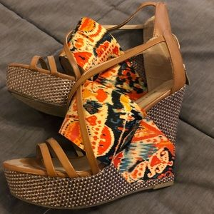 Size 9 1/2 wedge shoes. Worn 2-3 times. Colorful.